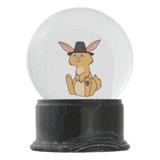 巡礼者の帽子が付いている感謝祭の子鹿のウサギ スノーグローブ