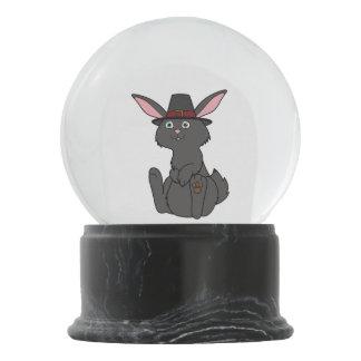 巡礼者の帽子が付いている感謝祭の黒いウサギ スノーグローブ