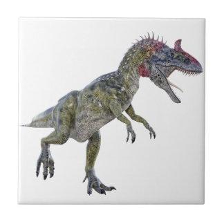 左に走っているCryolophosaurus タイル