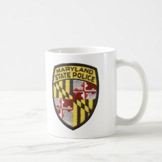 左手のコップ コーヒーマグカップ