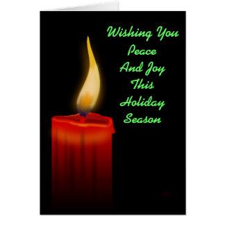 平和および喜びの赤い蝋燭ライト休日のクリスマス カード