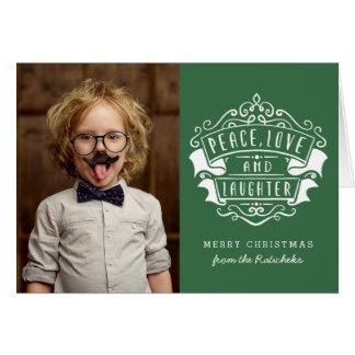平和、愛および笑い声のクリスマスの挨拶状 グリーティングカード