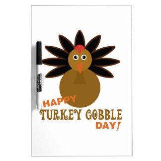 幸せなトルコは日の感謝祭をがつがつむさぼります ホワイトボード
