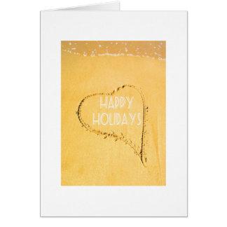 幸せな休日、ビーチの砂で描かれるLoveheart カード