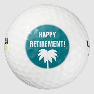 幸せな退職のゴルフ・ボールはヤシの木のロゴと置きました ゴルフボール