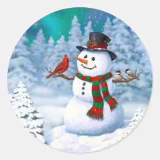 幸せな雪だるまおよび冬の鳥 ラウンドシール