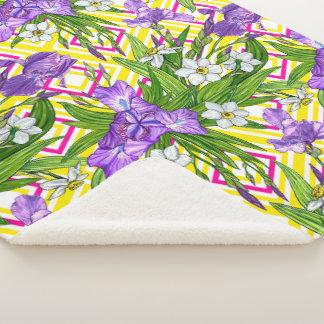 幾何学的なbの紫色のアイリスおよびスイセンの花 シェルパブランケット