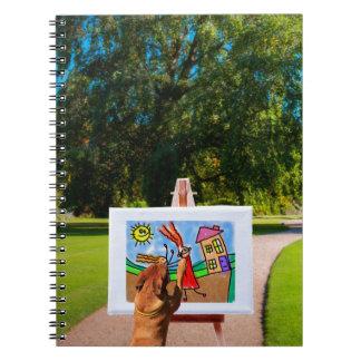 庭のブラシが付いている漫画を絵を描くことの後をつけて下さい ノートブック