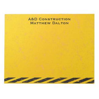 建築の黄色および黒いメモ帳 ノートパッド