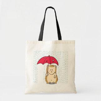 引き裂かれた傘を持つかわいいハリネズミ トートバッグ