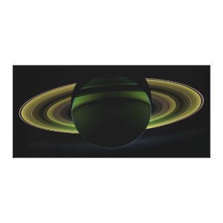 影を投げる惑星土星の後ろで照る日曜日 キャンバスプリント