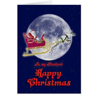 彼のそりのサンタを持つメリークリスマスの夫 カード