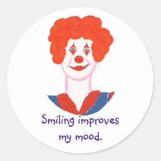 微笑する幸せなピエロの顔は私の気分を改善します ラウンドシール