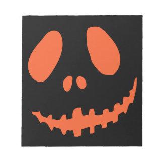 微笑のカボチャ顔 ノートパッド