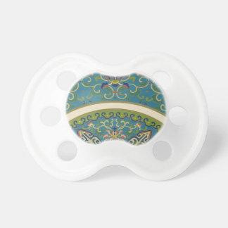 微笑の顔を搭載する青い東洋のデザイン おしゃぶり