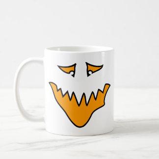 恐い顔。 オレンジモンスターのにやにや笑い コーヒーマグカップ