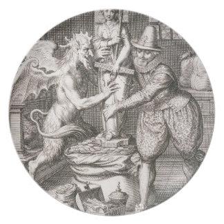悪魔は彼の袋のチャンスの彫像をの置きます プレート