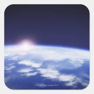 惑星の地球の上の朝日が付いている宇宙 スクエアシール