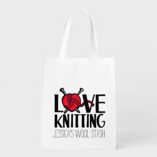愛編み物のウールは赤いバッグを隠匿します エコバッグ