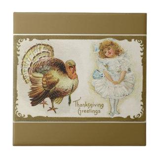 感謝祭トルコおよび小さな女の子の金ゴールドのタイル タイル