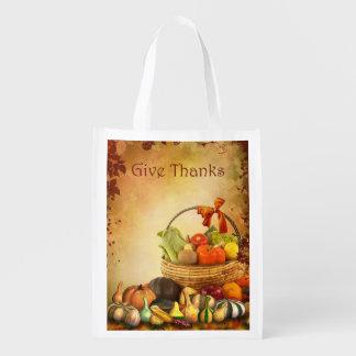 感謝祭、秋の収穫が付いているバスケット エコバッグ