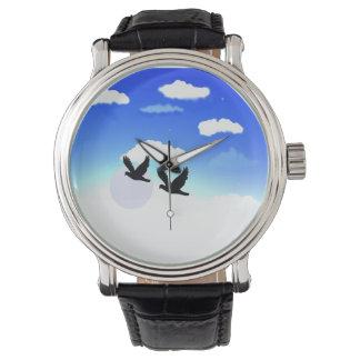 手の腕時計の鳥のイメージの空 腕時計