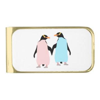 手を握っているピンクおよび青いペンギン 金色 マネークリップ