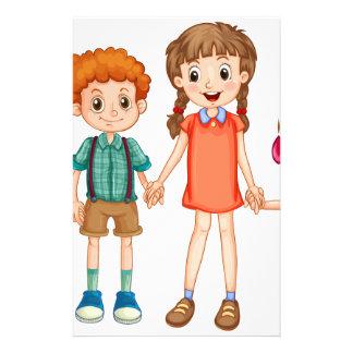 手を握っている男の子および女の子 便箋