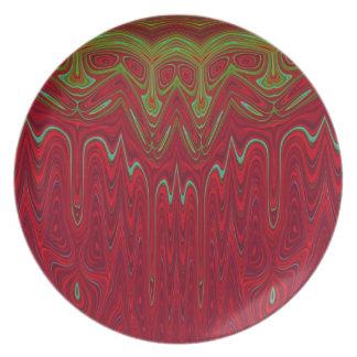 抽象的で赤いおよび緑の種族のデザイン プレート