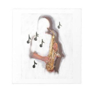 抽象的なサクソフォーンプレーヤー音楽楽器 ノートパッド