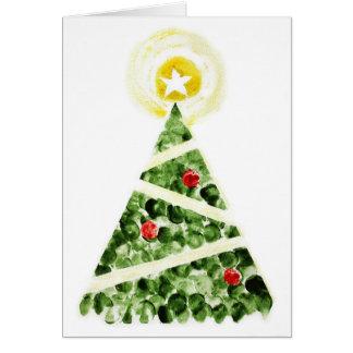 指によって絵を描かれるクリスマスの木 カード