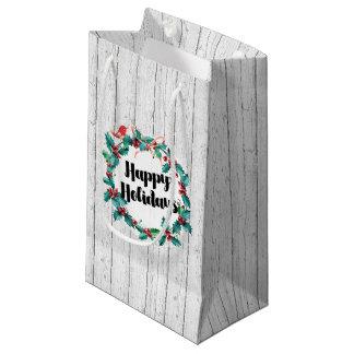 挨拶する素朴なヒイラギのリースの幸せな休日 スモールペーパーバッグ