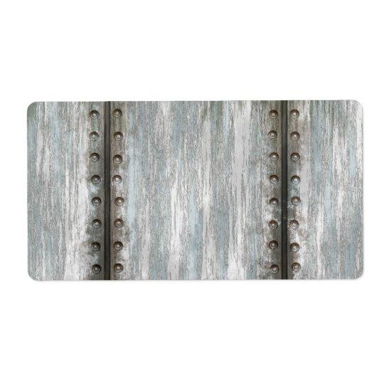 擦り切れたなリベットで留められた金属のグランジな織り目加工 ラベル