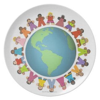 数々のな民族の置物は地球を囲みます プレート