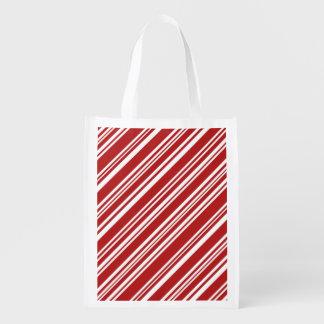 斜めの赤と白のペパーミントは縞で飾ります エコバッグ
