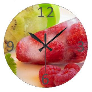 新しいキーウィのラズベリーのフルーツのような氷の棒つきキャンデーの写真 ラージ壁時計