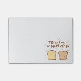 新年のしゃれのユーモアの紙吹雪へのかわいいトースト ポストイット