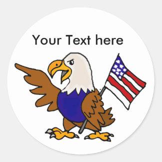旗の芸術を保持しているおもしろいのアメリカのワシ ラウンドシール