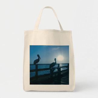 日の出のバッグの2羽のペリカン トートバッグ