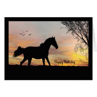 日没のバースデー・カードを持つシルエットの馬 グリーティングカード