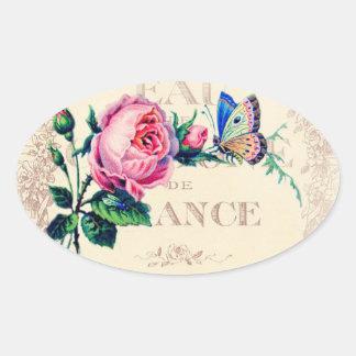 旧式でフランスのな香水のラベルの蝶は上がり、 楕円形シール