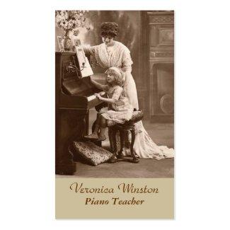 旧式な写真のピアノの教師の名刺