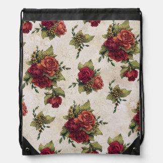 旧式な赤いバラの壁紙 ナップサック