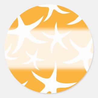 明るいオレンジおよび白いヒトデパターン ラウンドシール