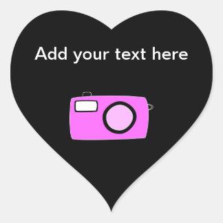 明るいピンクのカメラ。 黒 ハートシール