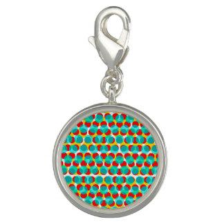 明るく青いオレンジ黄色の点の円形のチャーム チャーム