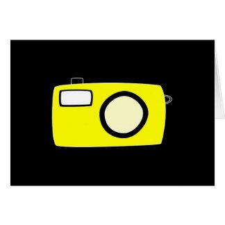 明るく黄色いカメラ。 黒 カード