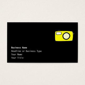 明るく黄色いカメラ。 黒 名刺