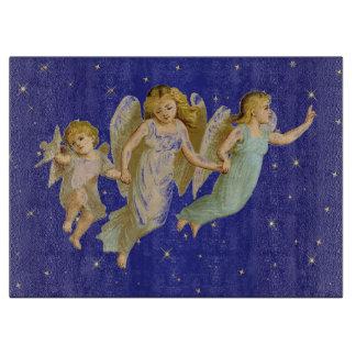 星明かりの青い背景の子供の天使 カッティングボード