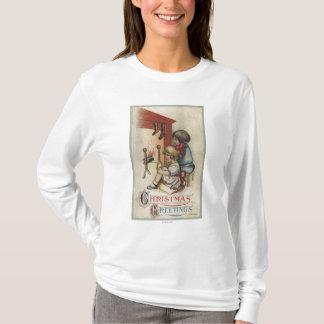 暖炉によるクリスマスのGreetingLittleの女の子 Tシャツ